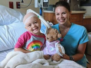 patient, child life specialist and teddy bear